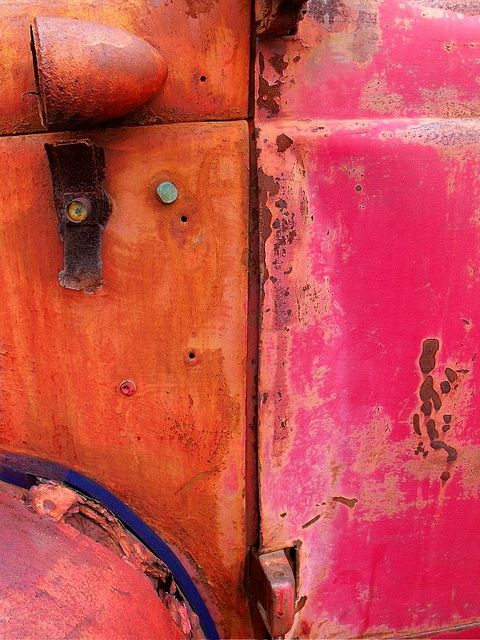 Pink & Orange Rust.  Colours on the side door of a truck no longer used in the distillery business that once made up the distillery area of old Toronto. Now the area is a historical landmark and used by artists and performers.