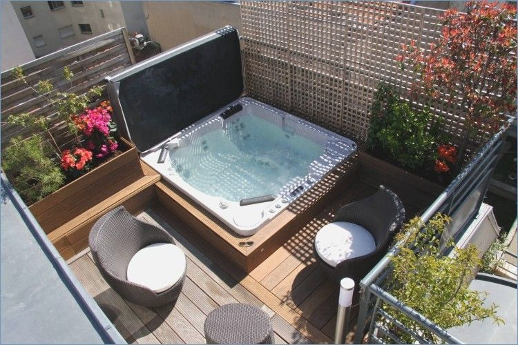 Whirlpool In The Garden Garden Whirlpool Garden Design Jacuzzi