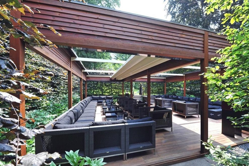 Modern Outdoor Pergola Ideas with Covered for Large Patio complete with  Large Outdoor Sectional Sofa and Table plus Chairs on Wooden Floor also  with Lush ... - Modern Outdoor Pergola Ideas With Covered For Large Patio Complete