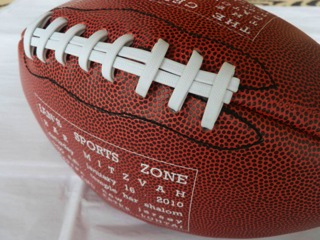 Bar Mitzvah invitation printed on a football from Little Black Dress Paperie! Just in time for the Super Bowl.
