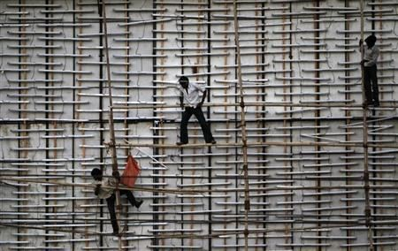 (Reuters) - India and Indonesia are not at immediate risk of credit rating downgrades, Fitch said on Thursday, but it warned it could act if the countries' governments fail to calm the current financial market tensions.