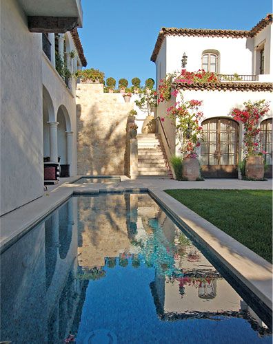 spanish style home and pool - note the steps going up the side of