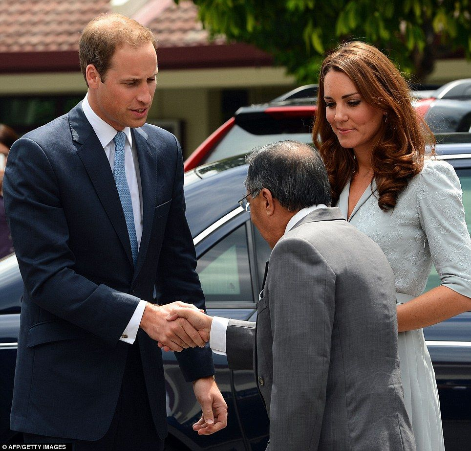 Prince William shakes hands with Richard Robless, council member of Hospis Malaysia, as he arrived with his wife. Kate made her first speech on foreign soil at the hospice