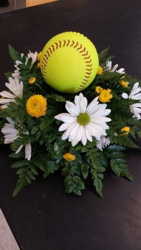 Softball banquet centerpiece with daisies floral