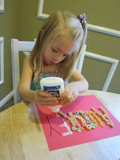 sweet little name craft; practice fine motor skills, do art and snack a little along the way! I might be able to do this with L.