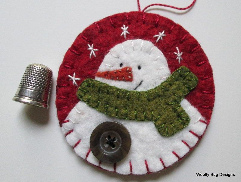 White Wool Felt Snowman with Button and Handstitched Snowflakes on Red Wool Felt Ornament. $12.00, via Etsy.