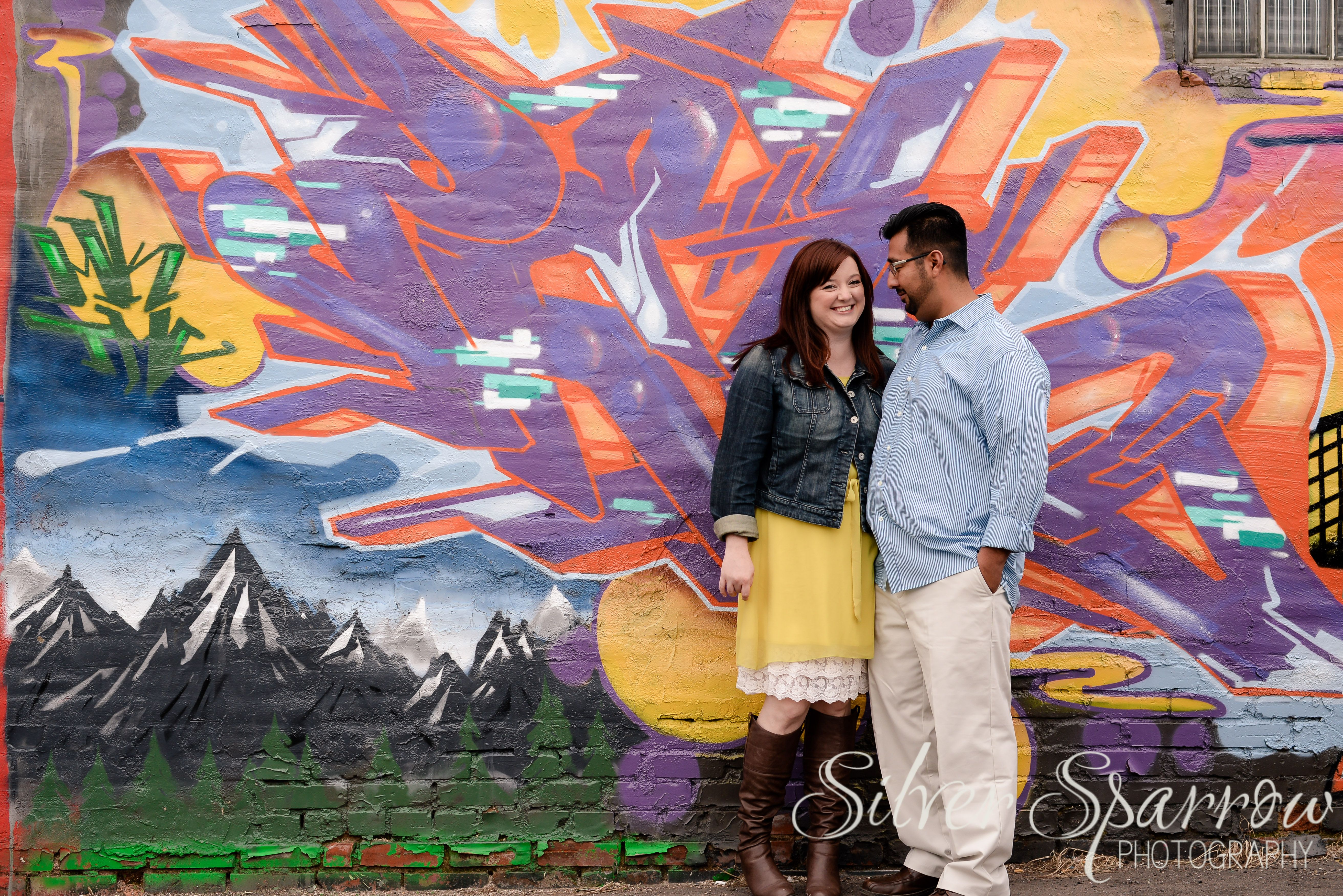 Urban engagement session in Denver. I LOVE the colors in the graffiti! www.SilverSparrowPhoto.com   #Engagement #Graffiti #DenverEngagement #UrbanEngagement #YellowDress