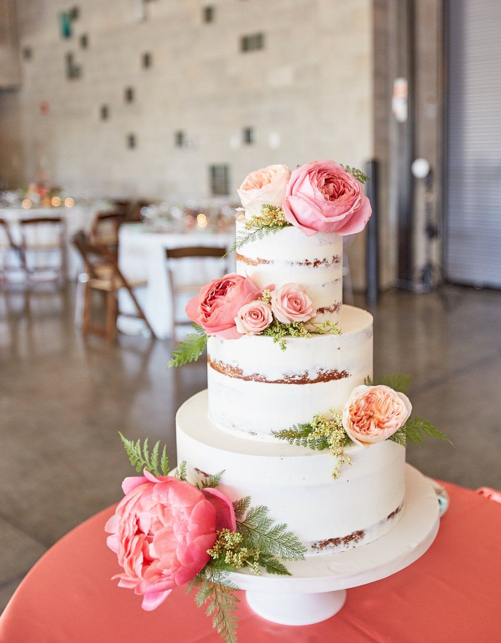 Three Tier Semi Naked Wedding Cake With Pink Flowers
