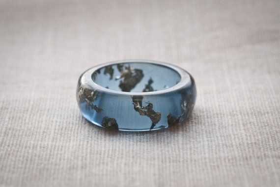 Blue ring of resin with gold-plated stacking flakes. Ring size (US) 10.