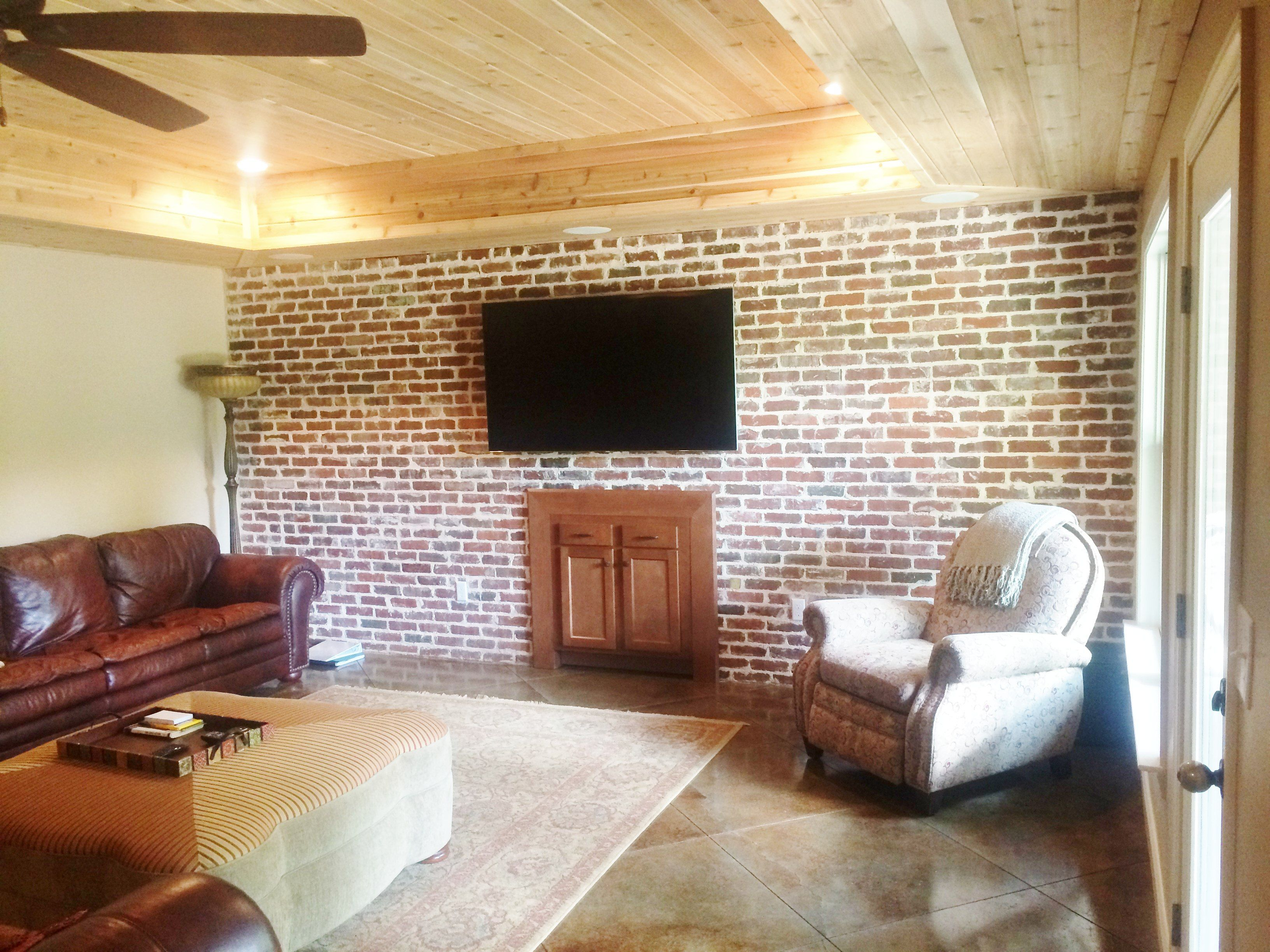 Scored and stained concrete floors, brick accents and v ...