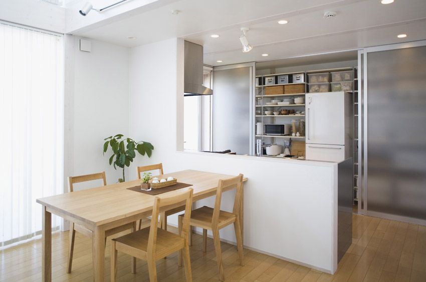 muji dining room and kitchen wood table and clear paneled cabinets on kitchen interior japan id=84170