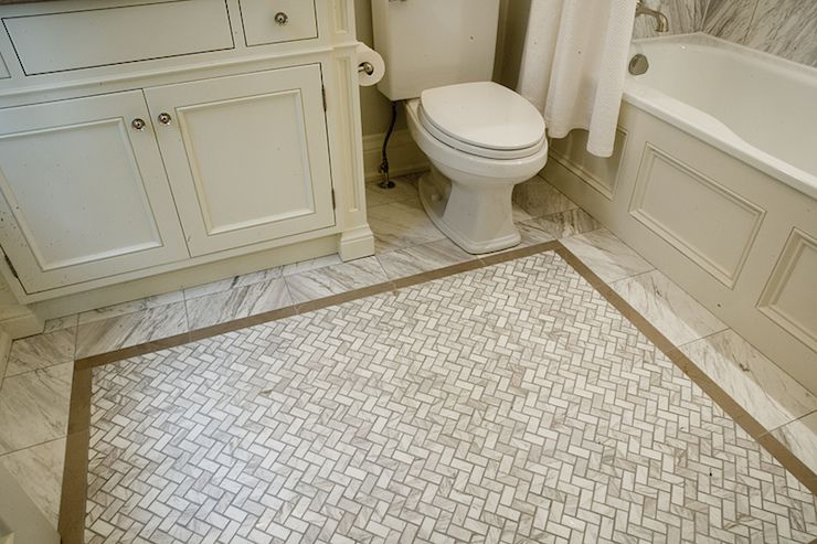 Stunning bathroom with ivory vanity beside toilet and