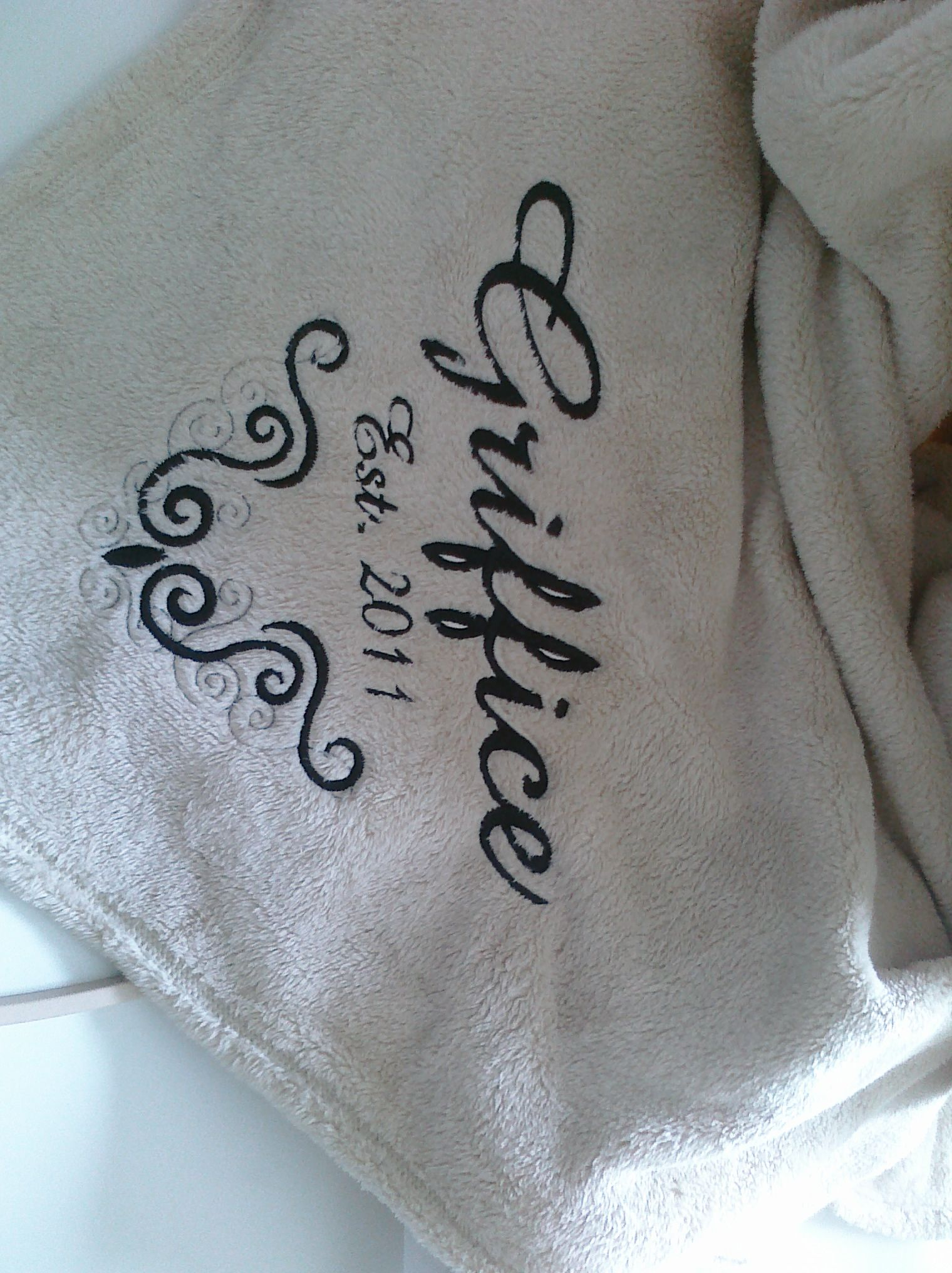 An Embroidered Blanket For A Wedding Gift