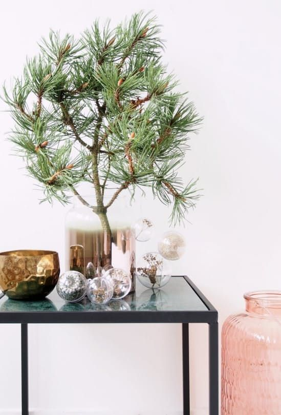 Lovely Christmas decoration with a large spruce branch and glass ornaments.