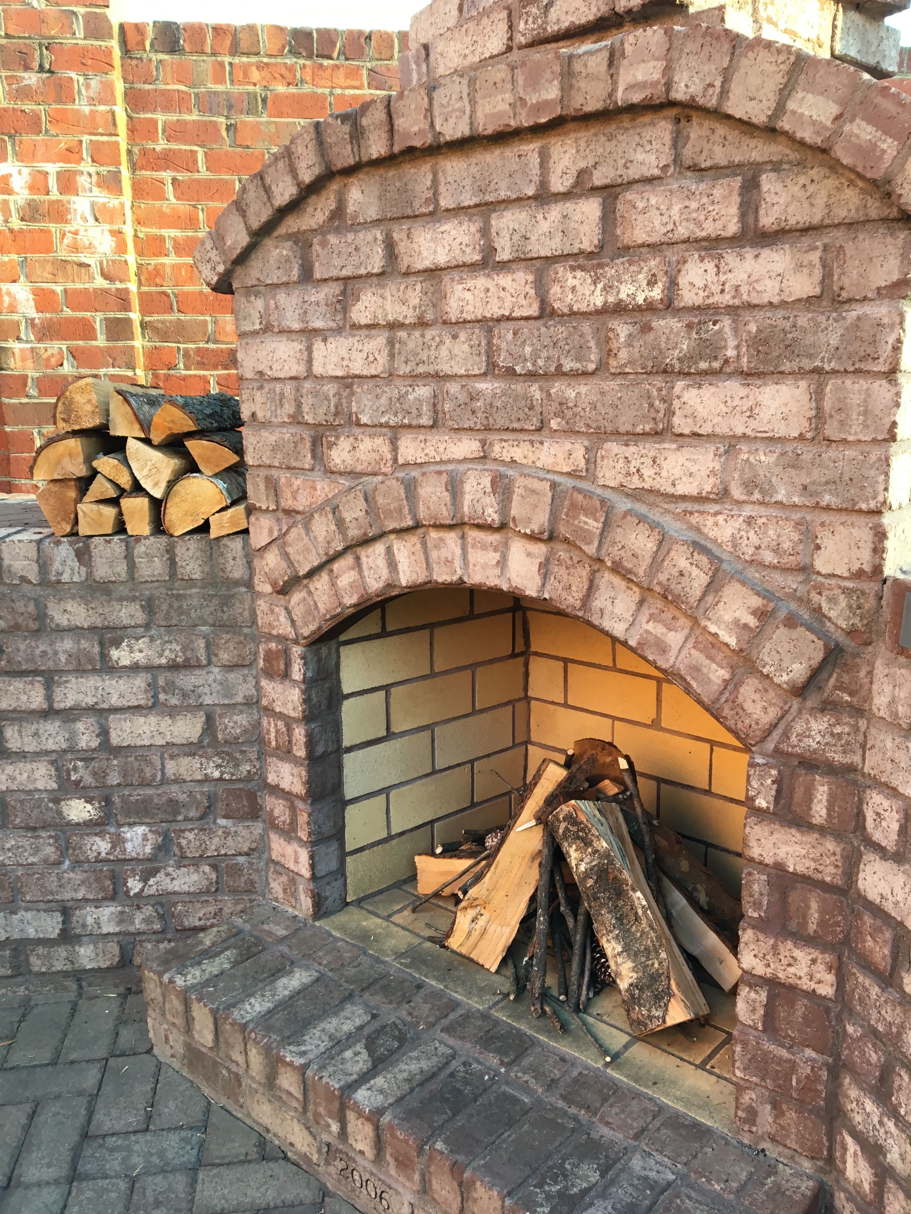 Outdoor Kitchen Fireplace Made Entirely Of Brick And Lined With