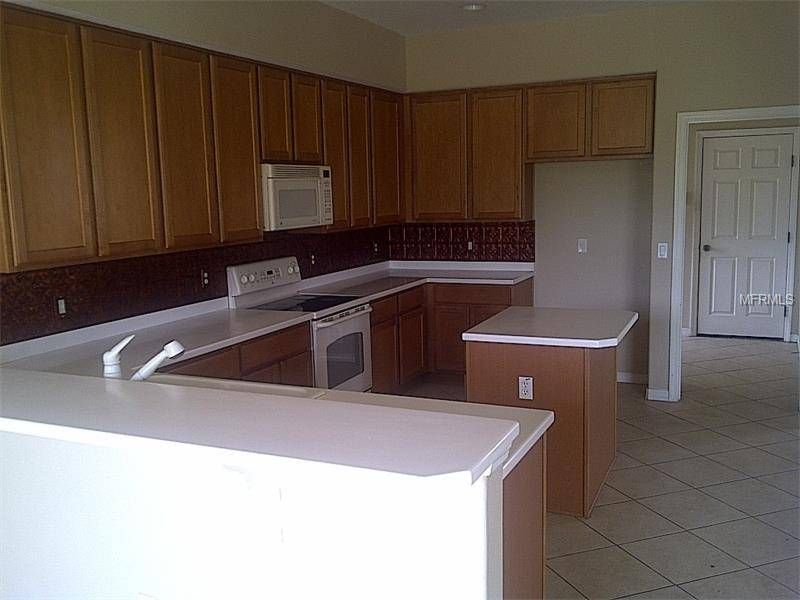 2 Story 5/3 Home on .64 Acres: 20 Min. to Disney & Golf Course   Just 20 minutes to Disney, Epcot, Animal Kingdom, Hollywood Studios, Champions Gate Golf Course, Dining and Entertainment. Currently there is a tenant in place.