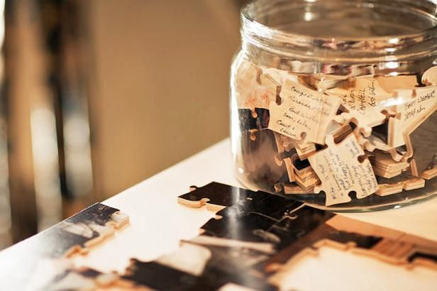 Wedding Guest Book Alternative: A photo of the couple is put on a jigsaw puzzle, then guests sign individual pieces. Later, the newlyweds can have fun putting it all together.