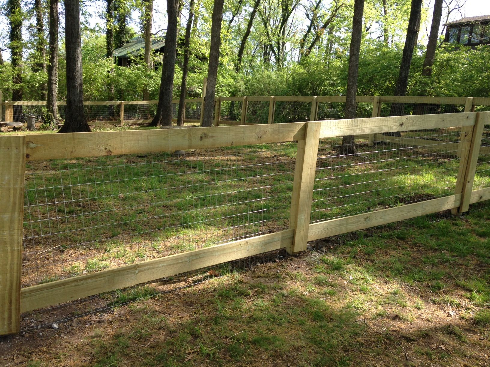 wood framed wire fence