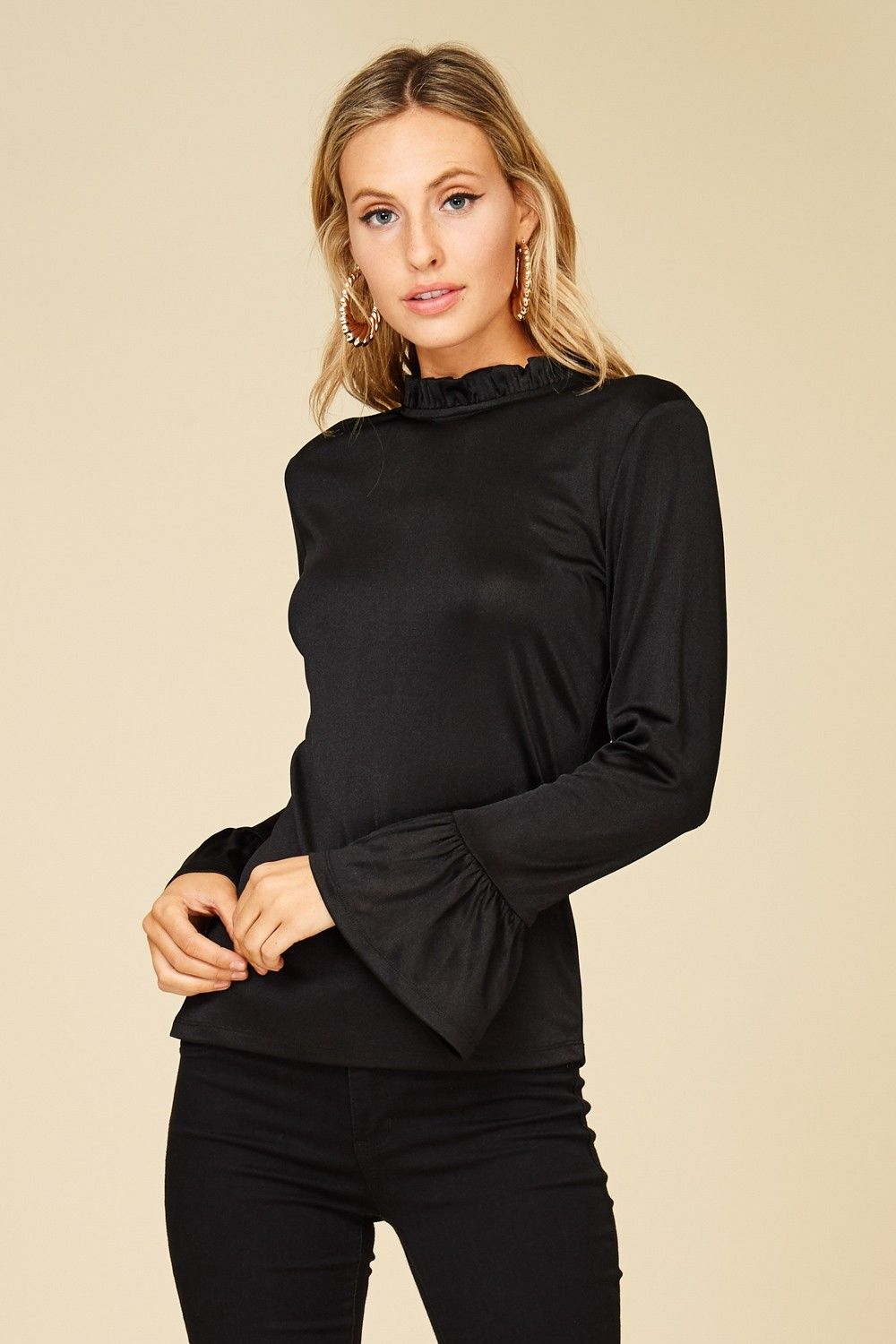 f85c0216 Long Bell Sleeve Knit Top with Back Tie Style# TC2112 A solid knit top  featuring long bell sleeve, mock neck, back tie, a soft and snug knit  material Poly ...