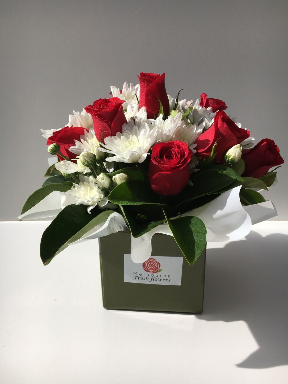 Make your dear ones feel loved with a bunch of red roses and white make your dear ones feel loved with a bunch of red roses and white chrysanthemum in a cute handle box arrangement from melbourne fresh flowers and see izmirmasajfo