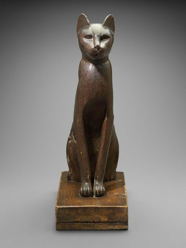 Wooden statue of a cat (front view). Late Period, dynasty 26–Ptolemaic Dynasty…