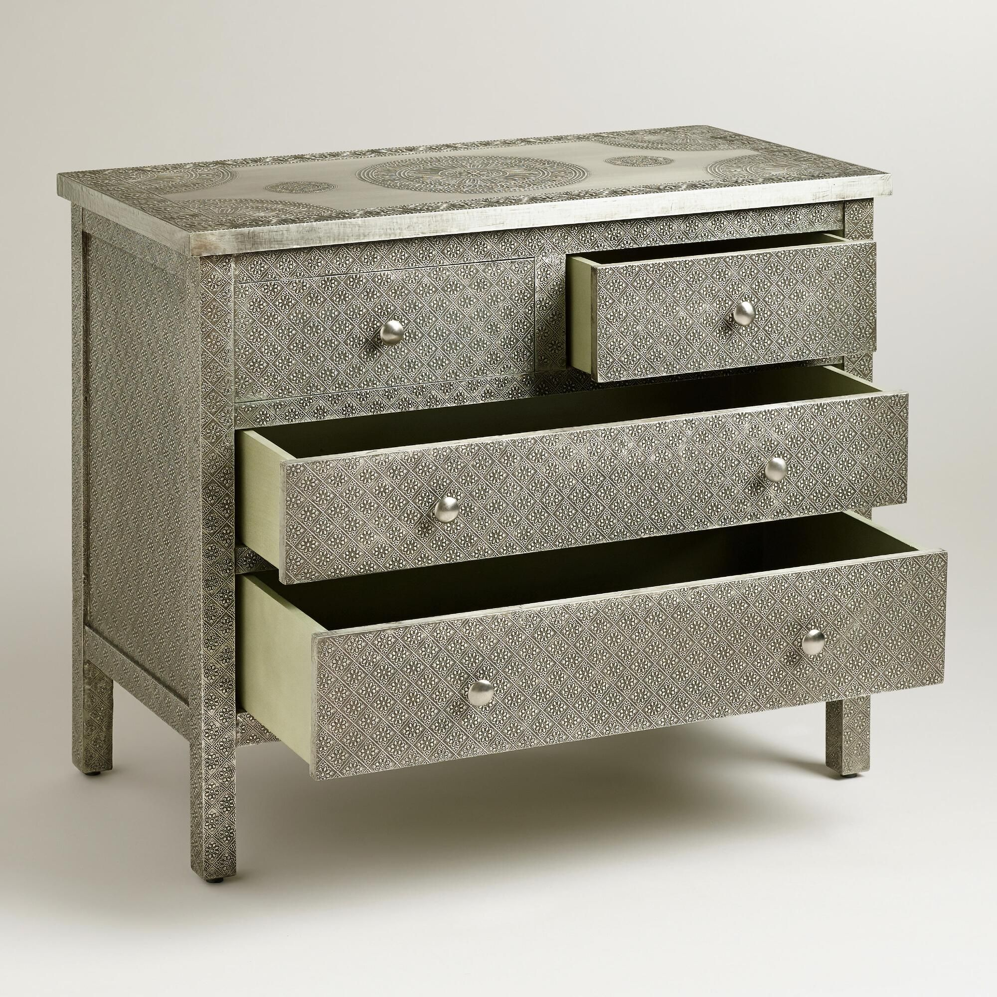 Crafted of mango wood wrapped in hand embossed metal our kiran embossed metal dresser is rich with character and versatility it features a medallion motif