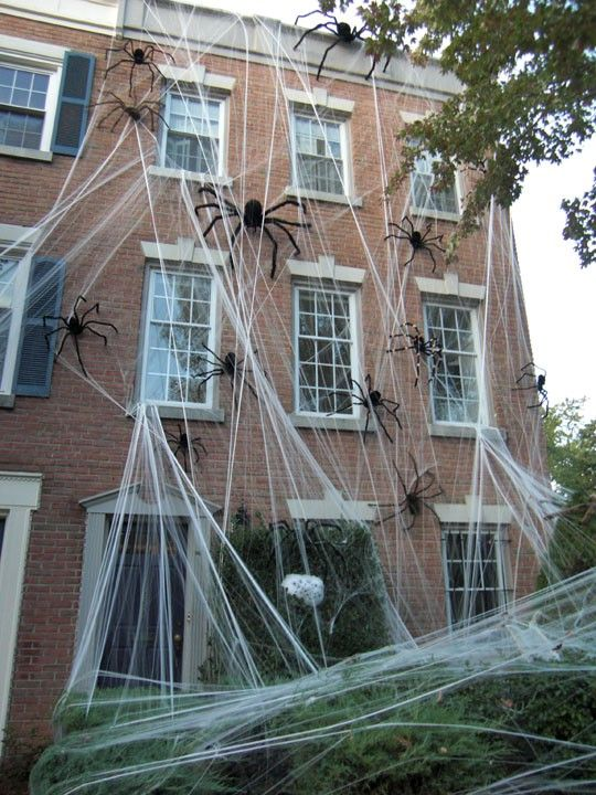 Inexpensive Spider Webs And Large Spiders A Great Way To Decorate On A Budge Halloween Outdoor Decorations Exterior Halloween Decorations Halloween Diy Outdoor