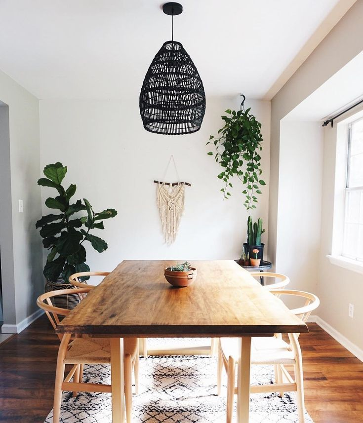 minimalist boho dining room with hanging plants and black rattan chandelier smo dining room on boho chic dining room kitchen dining tables id=92472