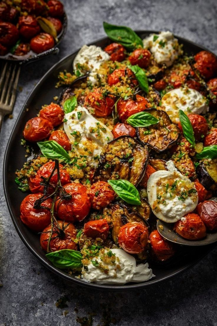eggplants, roasted tomatoes and burrata cheese with garlic herb br ... -  Grilled eggplants, roaste