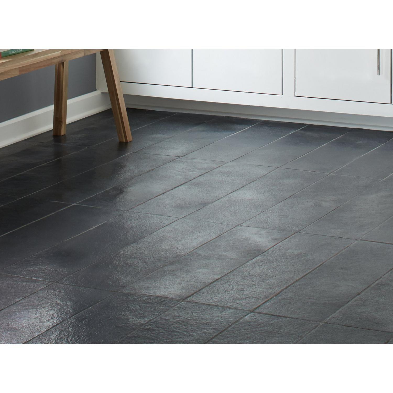 black brushed limestone tile floor