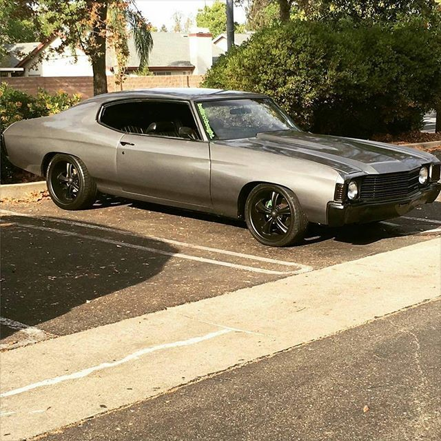 Sick 72 Chevelle with a 350 small block. grey black painted bumpers and wheels