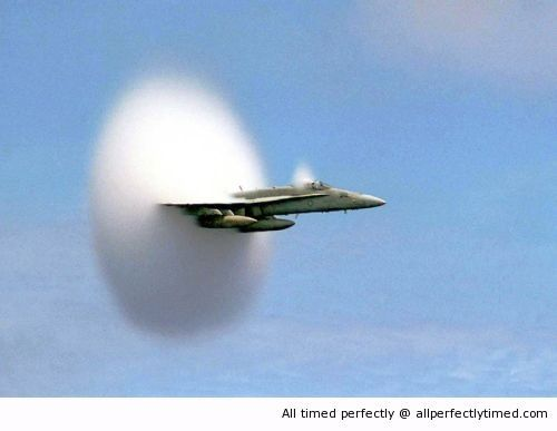 Fighter jet breaking the sound barrier
