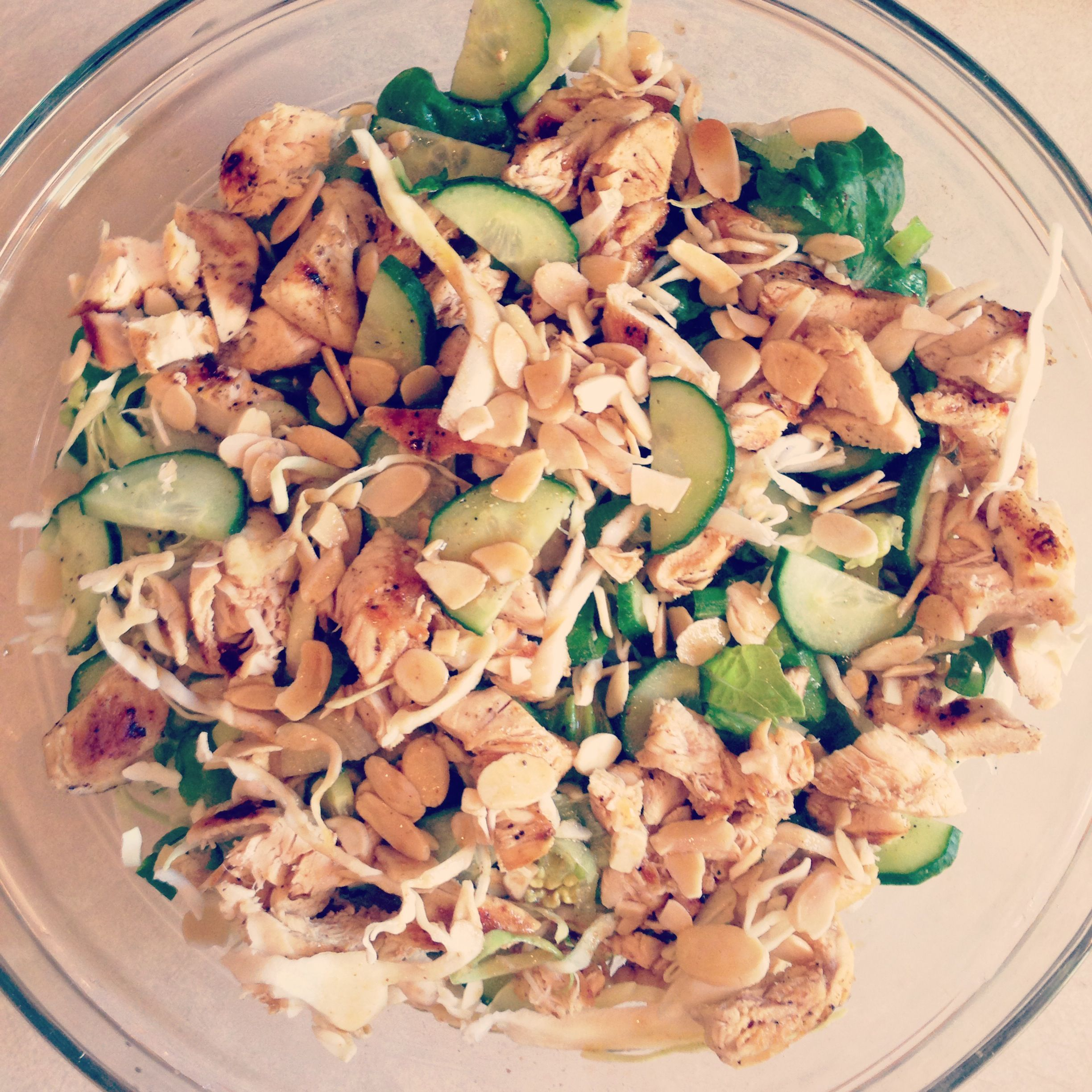 Made this delicious chinese chicken salad for dinner tonight! Salad: - Romaine lettuce, cabbage, green onion, cucumber, sliced toasted almonds, and chicken Dressing: - 2 tablespoons rice vinegar - 1 tablespoon soy sauce - 1 tablespoon sesame oil - 1 teaspoon ginger -1 teaspoon honey