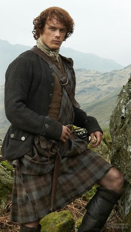 Sam Heughan as Jamie Fraser , great shot of full highland