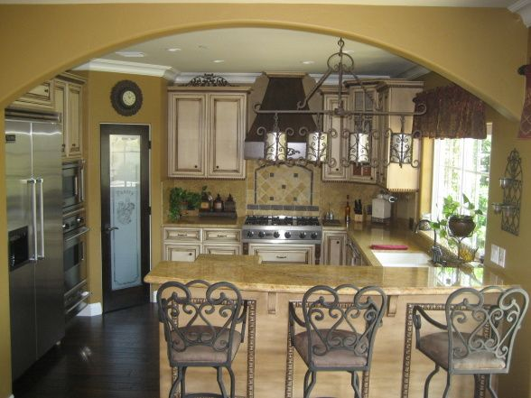 Kitchen Design Ideas Tuscan tying in dark wood floors with light cabinets/counters
