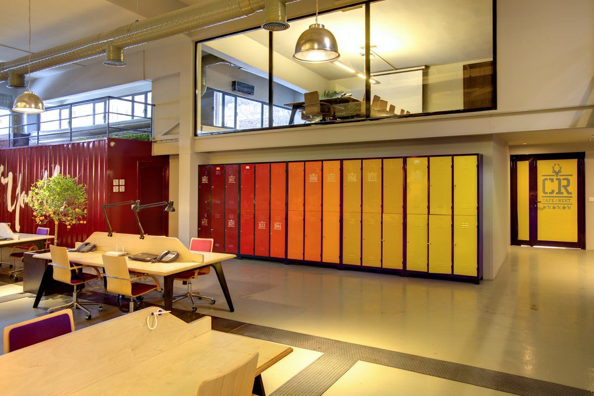 Employees lockers set in a warm hue 1200 800 for Office space design companies