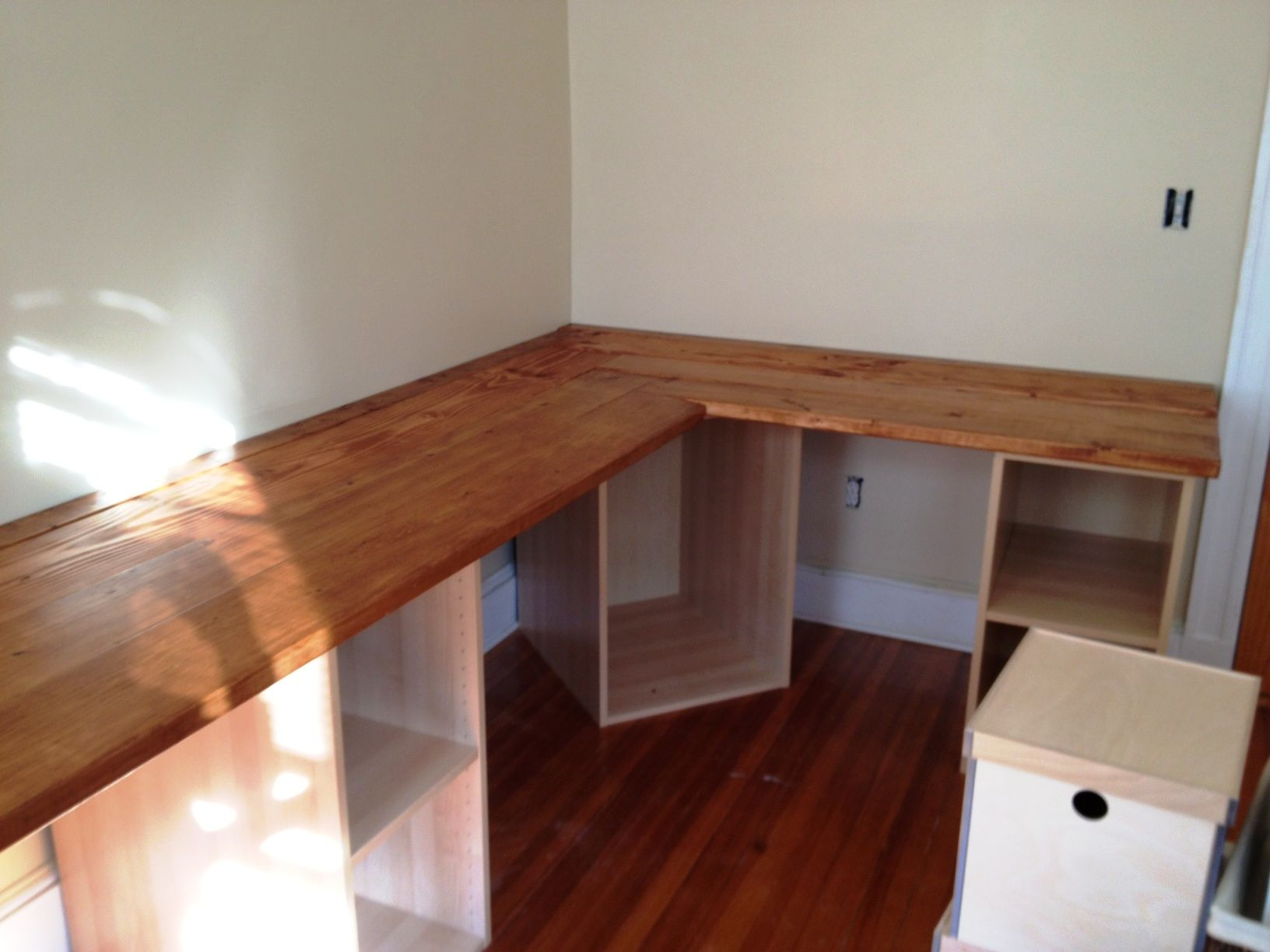DIY Built-in Desk Stained and Assembled. Ideas for how to do the corner.