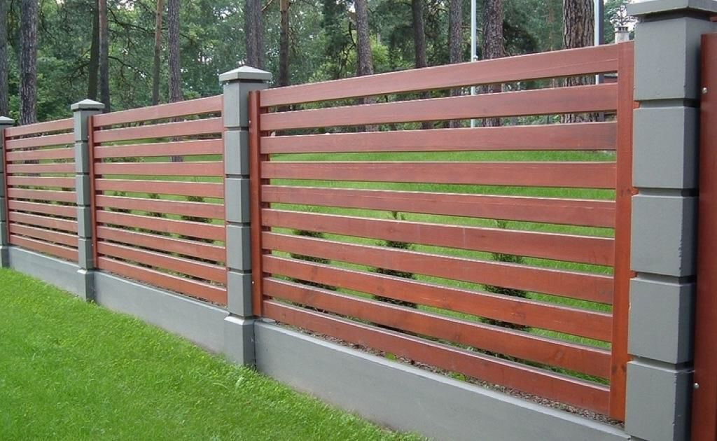 Image from http://www.drawhome.com/wp-content/uploads/2016/02/Fascinating-timber-fence-design-with-gray-concrete-poles-for-a-large-contemporary-garden-idea.jpg.