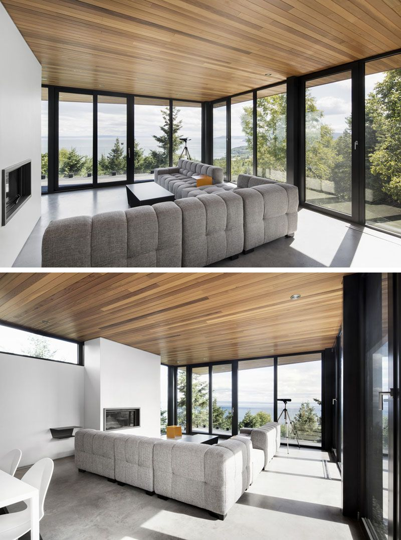 This living room is surrounded by black framed floor to - What are floor to ceiling windows called ...