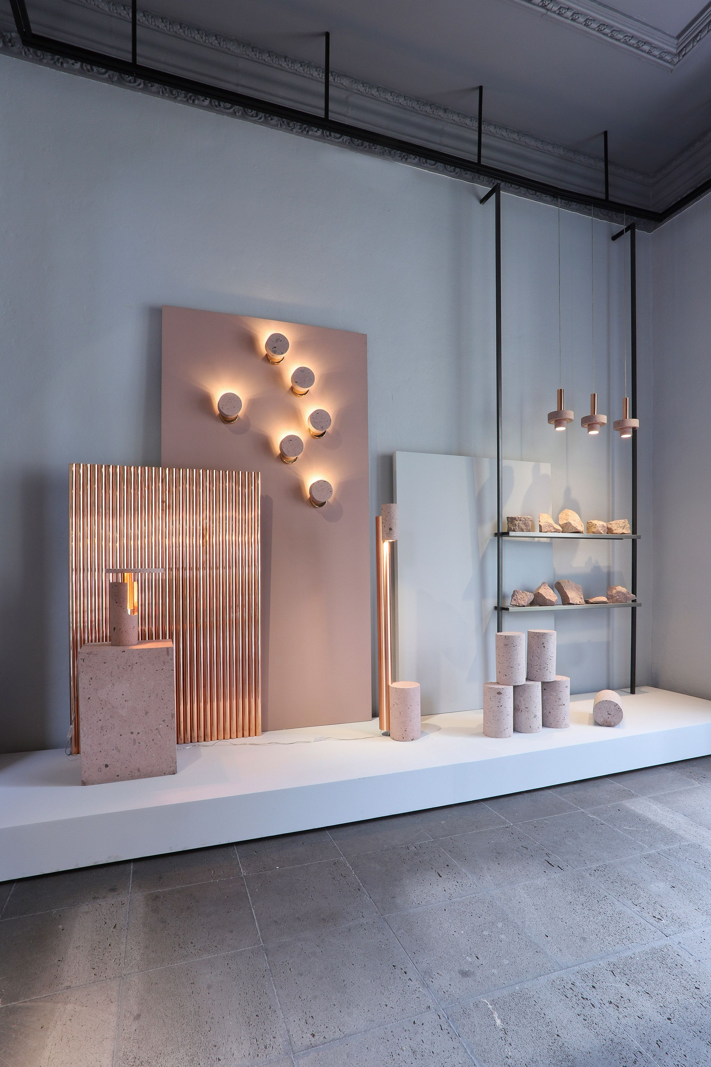 Throughout the showroom, products are shown alongside raw ...
