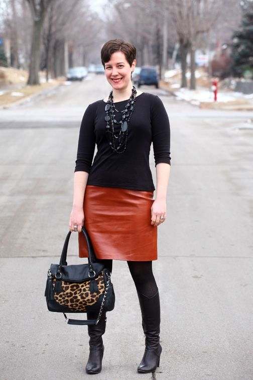 Black tee, black necklaces, cognac leather skirt, black tights and ...