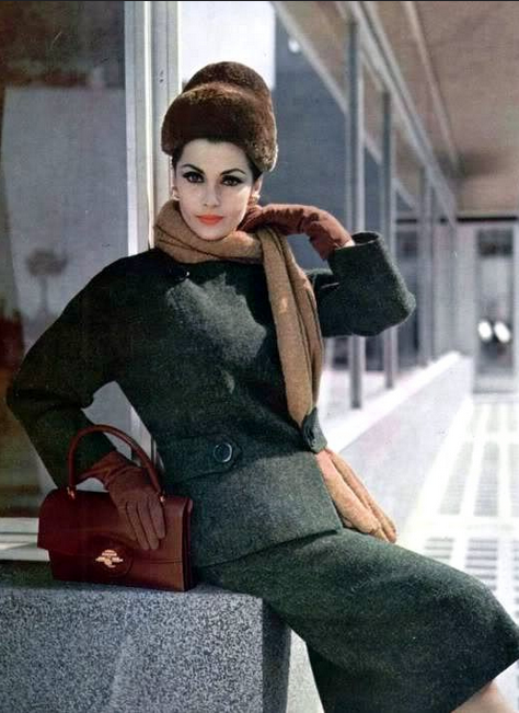 1959 Tweed suit and scarf by Grès, fur hat by Christie, gloves and handbag by Hermès