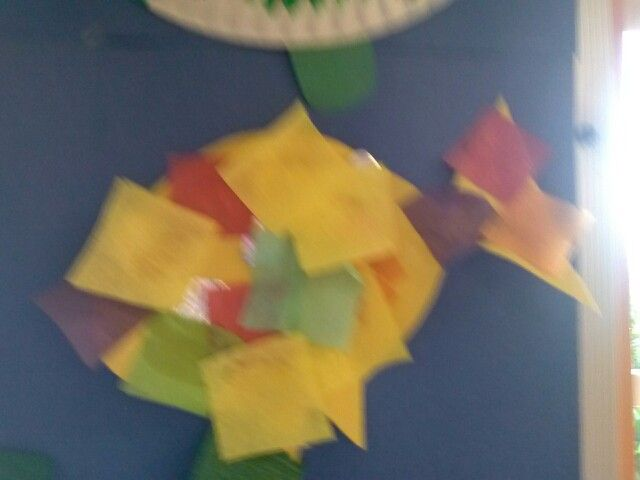Rainbow fish collage (construction paper, tissue paper, streamers, foil, etc.)