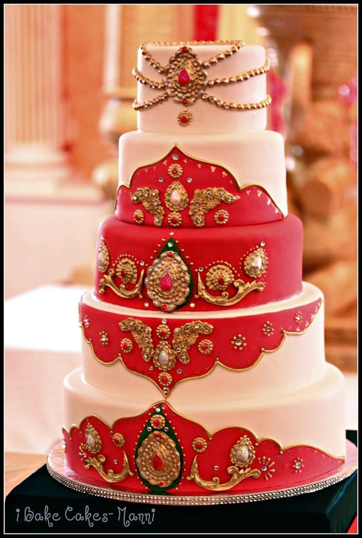 Beautiful White Indian Wedding Cake With Red Gold And Green Accents