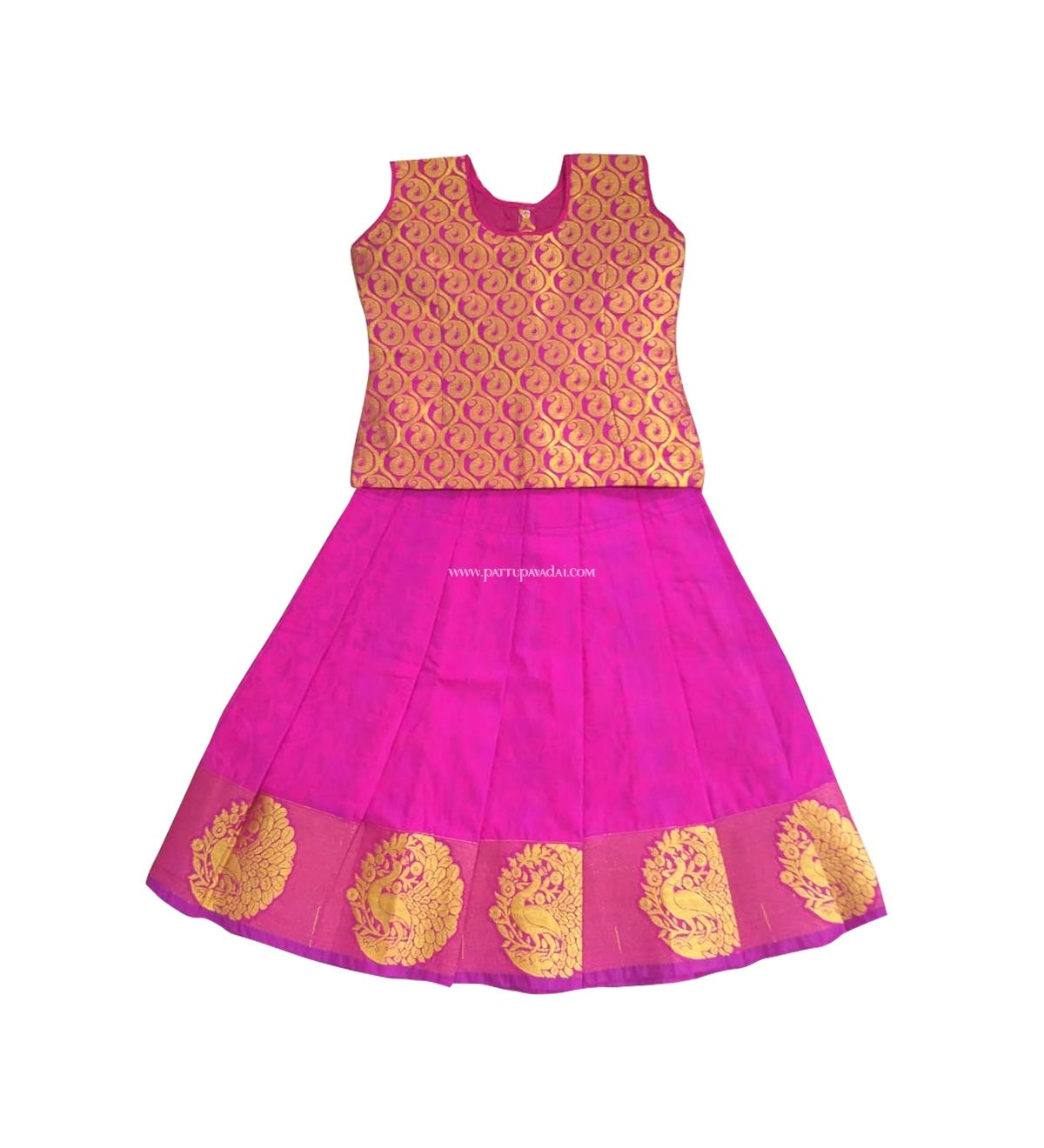 828434b9a9 Sleeveless golden buttas Pattu pavadai in pink and golden color. The skirt  has golden peacock silk prints in the border.