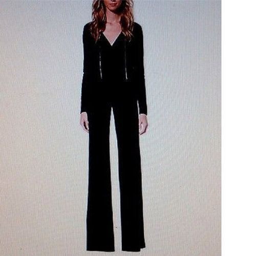 MICHAEL KORS NWT, JERSEY CHAIN JUMPSUIT, great for any night out!  Size MEDIUM  Model QH43GBXC76  Crafted soft matte-jersey, this jump suit fuses high style with comfort  A defined V neckline is framed by delicate chain detailing for just the right amount of edge.   *also available in sz Small and large. ONLY 1 OF EACH!  WILL SHIP RIGHT AWAY! Check out my other amazing items