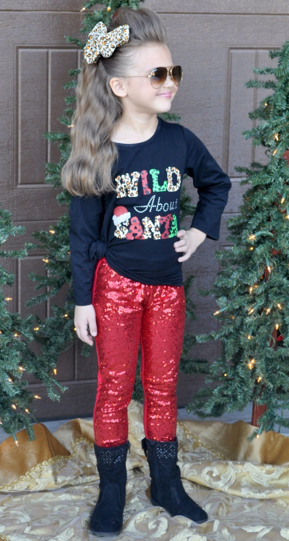 "The ""Wild About Santa"" boutique outfit is right on trend this holiday season! The soft and comfortable little girl's Christmas outfit is made of cotton and spandex for added comfort!  The sparkly red sequin leggings add that extra flair!   Any little fashionista will love wearing this for Christmas parties, photo shoots, Christmas Eve, Christmas Day, family pictures, or just everyday all winter!     Top quality and true boutique style at wholesale price!     This outfit runs true to size so…"