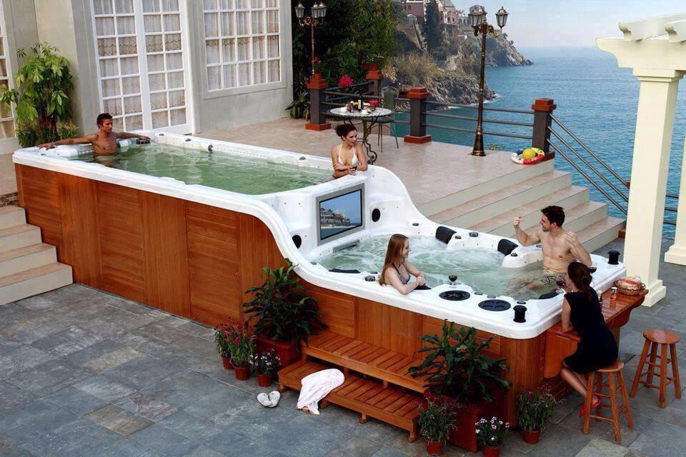 Wood Paneling Cover A Jacuzzi/pool With Bar And Sound System