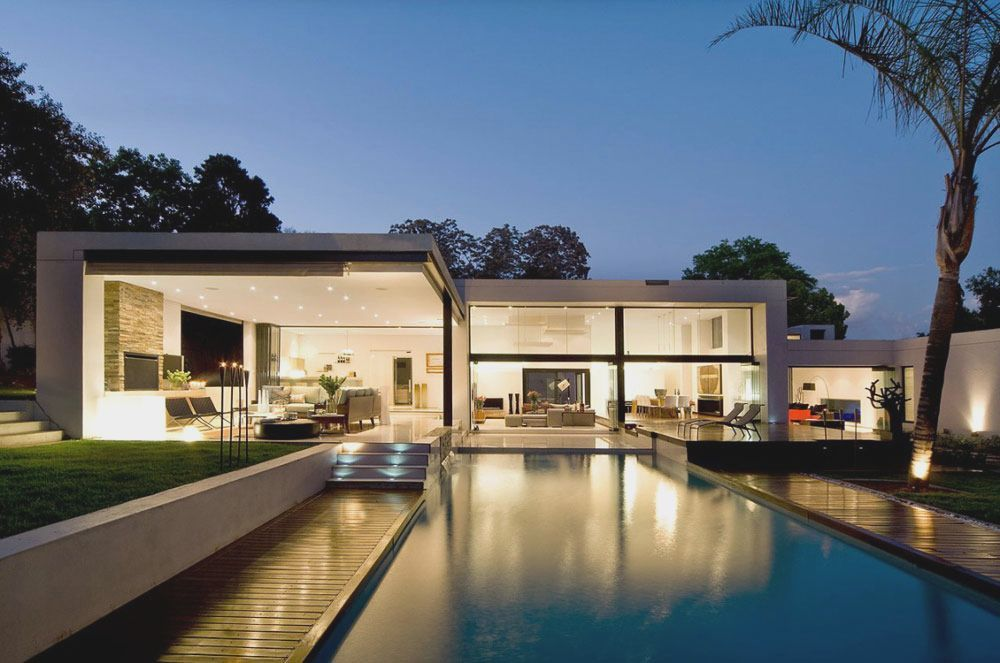 Contemporary prefab house in the bauhaus style with glass facade and pool in the garden