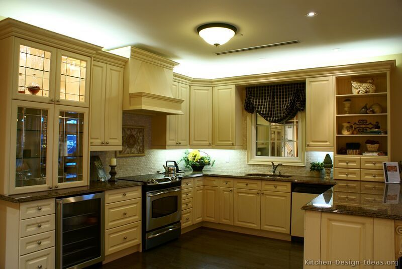 How black appliances look in a cream colored kitchen. Traditional Antique White  Kitchen Cabinets #